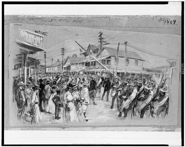 A street scene at Tampa City -- troops coming