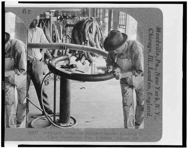 Stripping tube on mandrel before sending to cure, Goodyear Tire Factory, Akron, O.