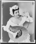 [Katherine Dunham, three-quarter length portrait, in costume for play]