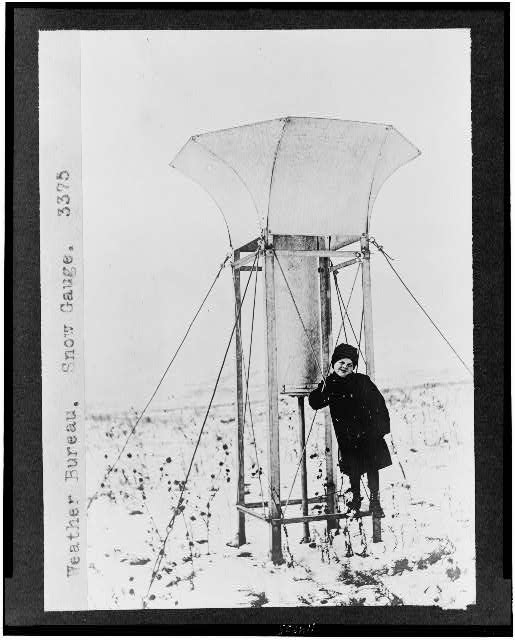 [Child standing on snow gauge of the Weather Bureau]
