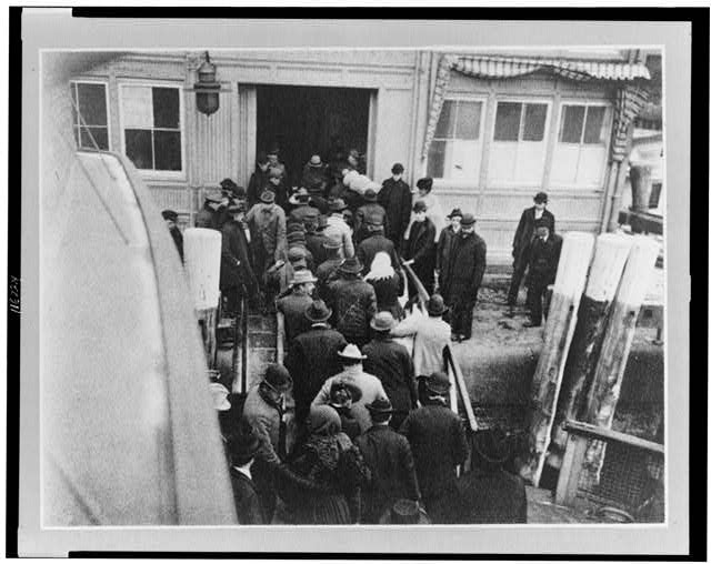 The Battery, New York - outside of barge office - landing of the emigrant passed from the ferry-boat which brings them from Ellis Island to the Battery