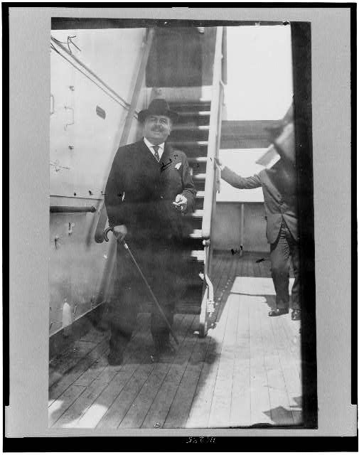 [Victor Herbert, full-length portrait, standing, on the deck of the (ship?) Imperator(?), facing front]