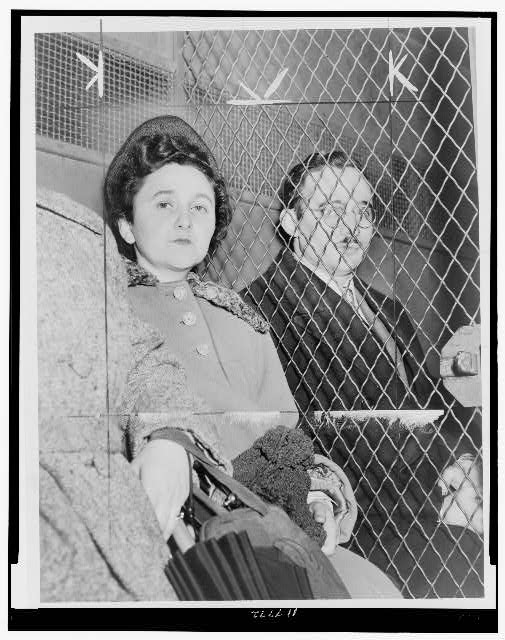 [Julius and Ethel Rosenberg, separated by heavy wire screen as they leave U.S. Court House after being found guilty by jury]
