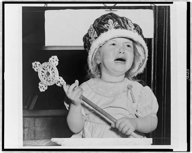 [2p1s/b2s year old Jean Hunter crying, wearing an oversized crown and holding a scepter at a mock coronation at the Madison Square Boys Club, New York City]
