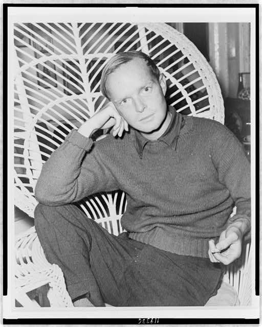 [Truman Capote, half-length portrait, facing front, seated in a chair, resting head on his right hand, holding cigarette in his left hand]