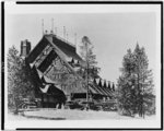 [Old Faithful Inn, with automobiles parked in front, Yellowstone National Park, Wyoming]