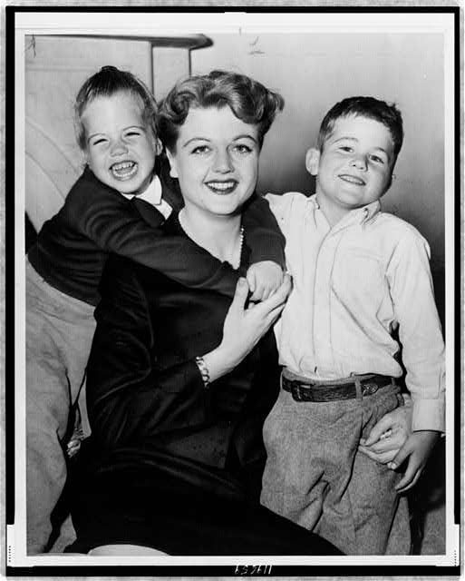 [Angela Lansbury, three-quarter length portrait, seated with daughter Deidre and son Andrew]