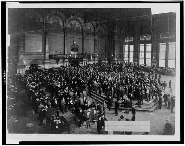 An Instantaneous flash picture of the Chicago Board of Trade in session