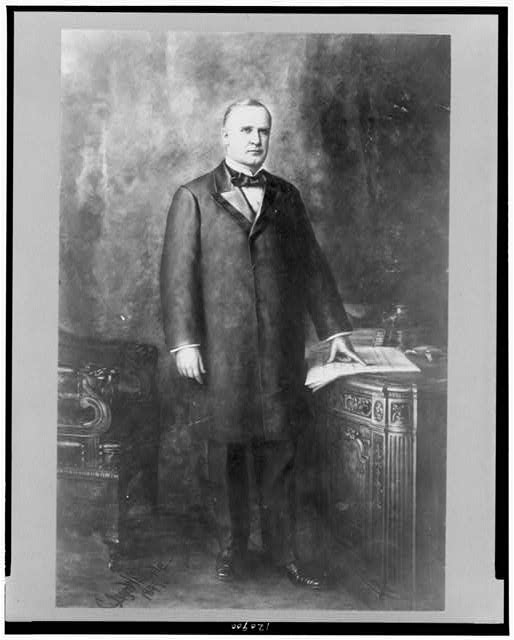 [William McKinley, full-length portrait, standing, facing slightly right, hand on document]