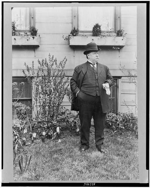 [William Howard Taft, full-length portrait, standing on lawn, facing right]