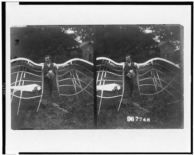 [Stereograph of man with device designed for flying]
