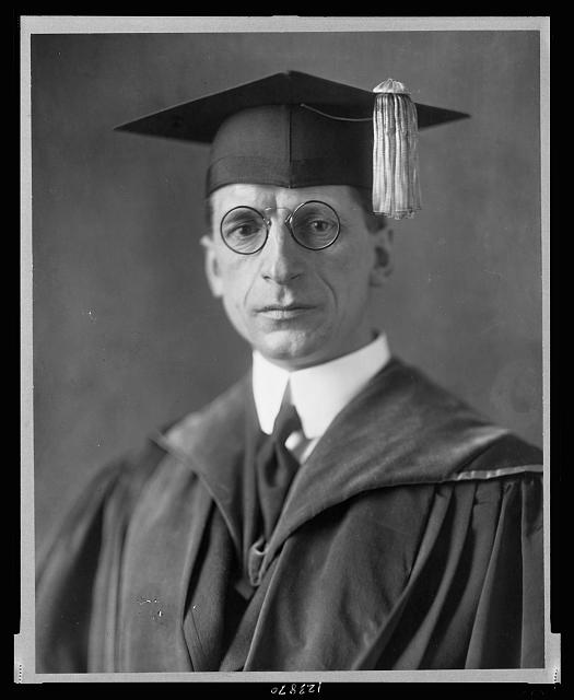 [Eamon De Valera, head-and-shoulders portrait, facing front, wearing cap and gown]