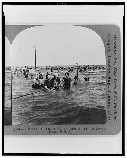 Bathing in the Gulf of Mexico at Galveston, Texas USA