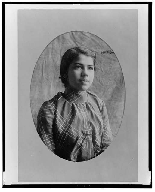[African American woman, half-length portrait, facing slightly right]