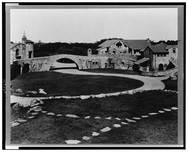 "[""Surprise Valley Farm,"" Arthur Curtiss James property, Beacon Hill Road, Newport, Rhode Island. Courtyard and stone buildings]"