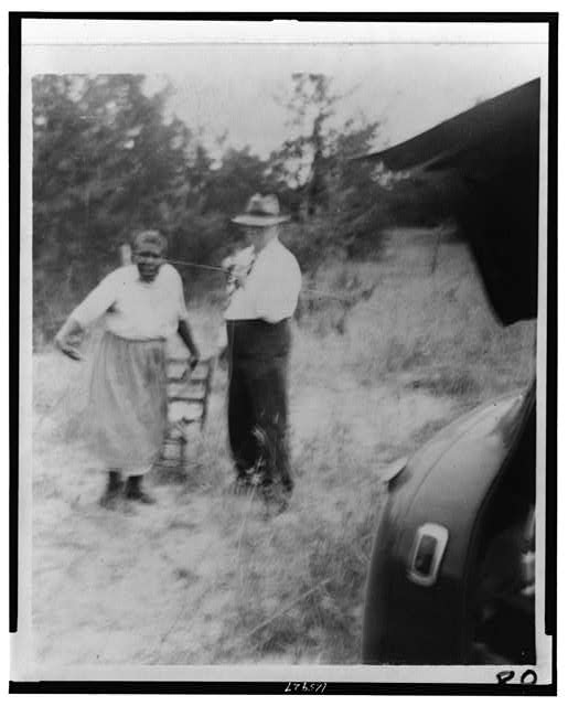 "[Aunt Harriet McClintock, dancing for John A. Lomax, Sr., as she sang ""Shing, Shing,"" at the crossroads near Sumterville, Ala.]"