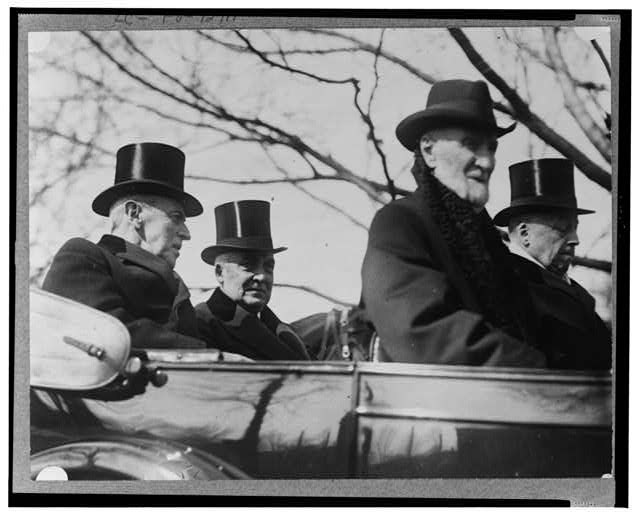 [Woodrow Wilson, Warren G. Harding, Philander Knox, and Joseph Cannon, in convertible, March 4, 1921]