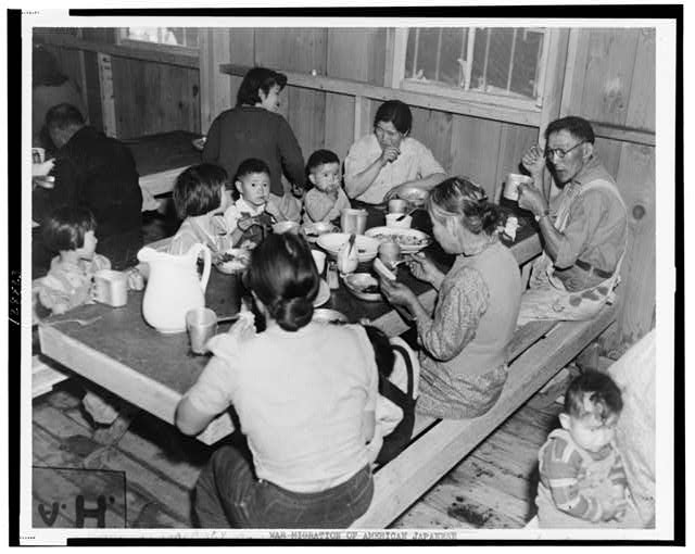 Manzanar, Calif., April 1942. Mealtime at the Japanese war relocation center
