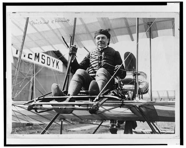 [Mikhail Effimov, Russian aviator, full-length portrait, seated on airplane, facing front]