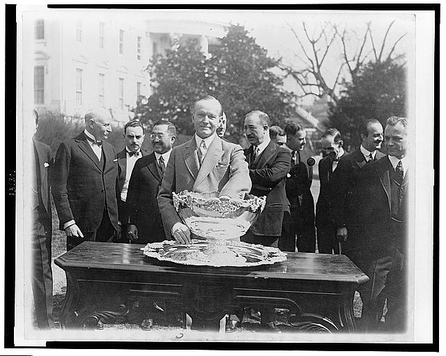 President Coolidge makes tennis draw at White House--Drawing for the Davis Tenni[s] matches was held at the White House with practically all of the Diplomati[c] Corps in Washington looking on