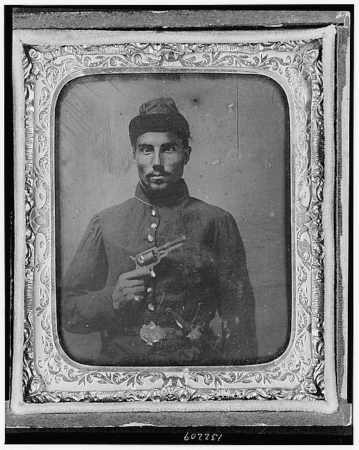 [African American soldier, half-length portrait, with pistol and jacket]