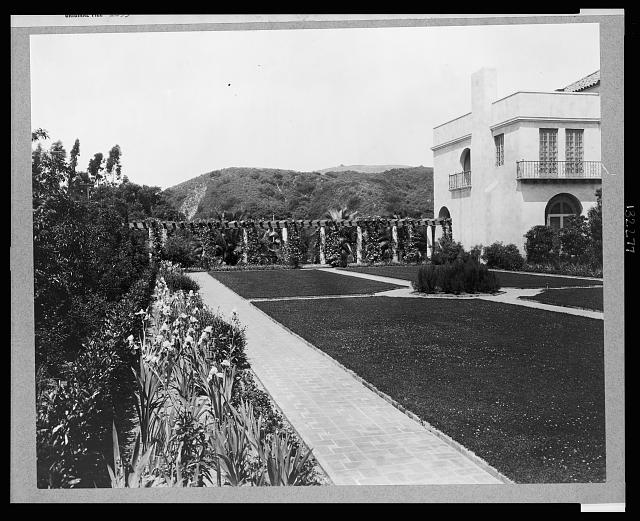 Pasadena, California, Mrs. Herbert Coppell home - view of formal lawn, gardens, and hills in background
