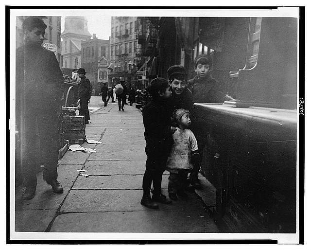 Children on a littered Chinatown street