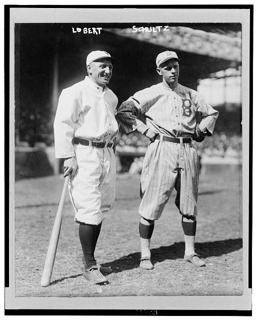 [Baseball players Hans Lobert of the New York Giants (left) and Joe Schultz, Sr. of the Brooklyn Dodgers (right), full-length, standing]