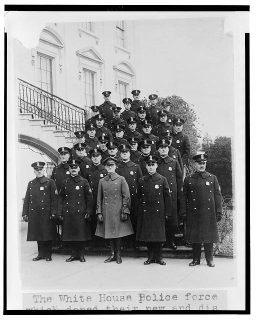 The White House police force which doned [sic] their new and distinctive uniforms today - photographed on the south portico of the White House