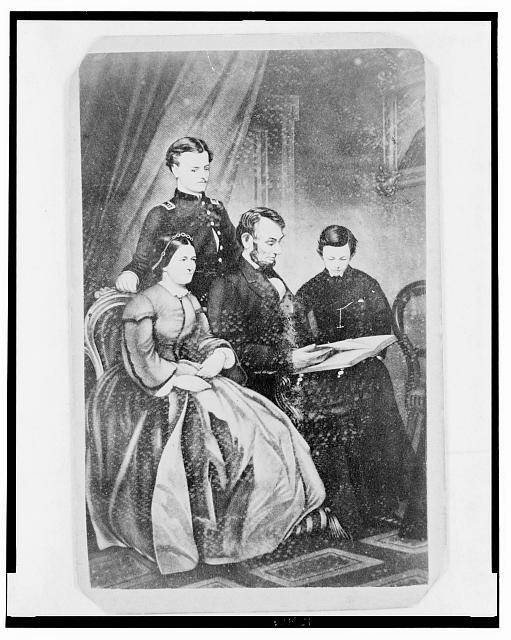 [Abraham Lincoln and family looking at a book]