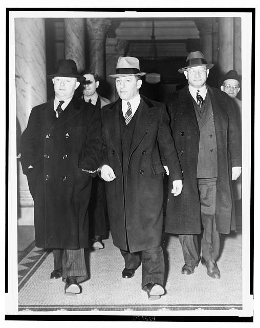 "[Louis ""Lepke"" Buchalter, center, handcuffed to J. Edgar Hoover, on the left, with another man on the right, at entrance to courthouse]"