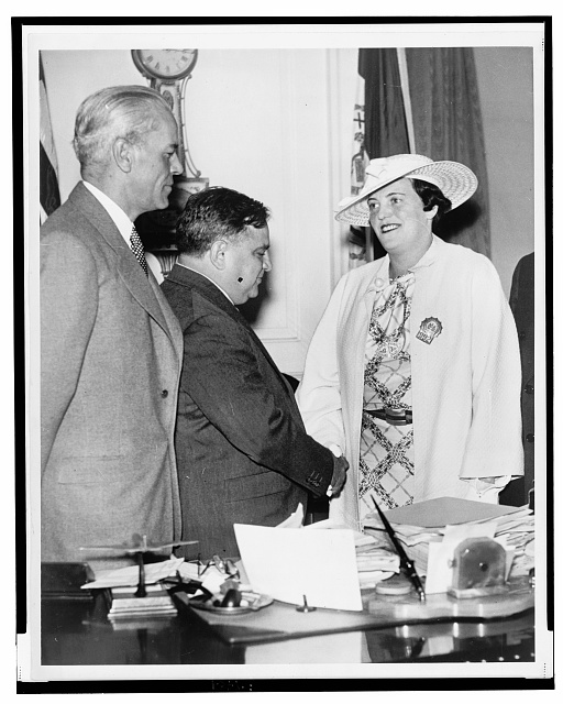 Mary A. Shanley being congratulated by Mayor La Guardia, Deputy Chief Inspector John Lyons looks on