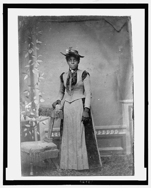 [Young African American woman, full-length portrait, standing]