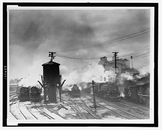 [Locomotive and a watertower at the Erie Railroad yards, Jersey City, N.J.]