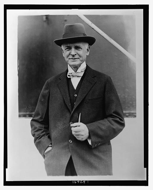 [Fairfax Harrison, president of Southern Railway, half-length portrait, standing, facing front, on board ship]