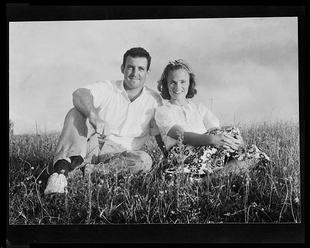 [Muriel and Malcolm Bell, Jr., sitting in the grass, in Nassau, Bahamas]