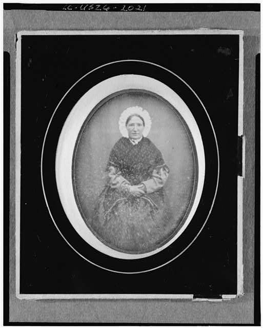[Unidentified woman, three-quarter length portrait, facing front, seated]