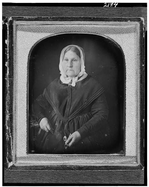 [Mary Manuel Lisa, half-length portrait, facing slightly left, seated, holding glasses]