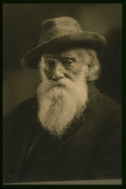 [John Burroughs, head-and-shoulders portrait, wearing hat and coat, seated, facing front]