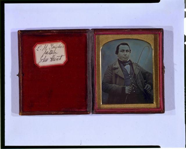 [Occupational portrait of John Hunt, half-length, facing front, holding whip]