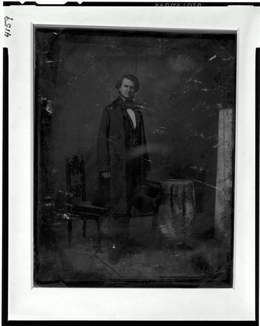 [Taliaferro Preston Shaffner, full-length portrait, three-quarters to the right, head front, standing, holding a tall hat. On the left is a chair and on the right a small table covered with tablecloth]