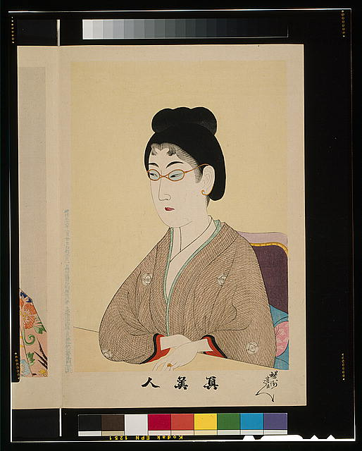 [Japanese woman wearing wire spectacles]