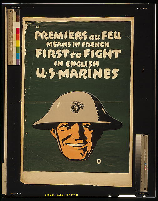 Premiers au feu means in French first to fight, in English U.S. Marines
