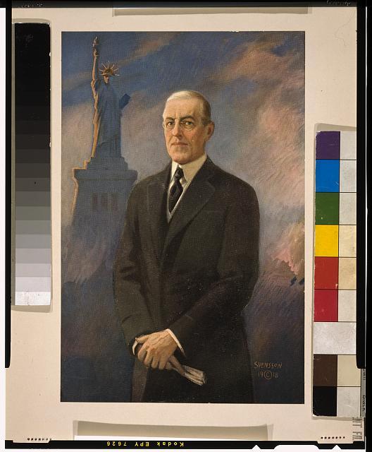[Woodrow Wilson, half-length portrait, standing, facing left, Statue of Liberty in background]