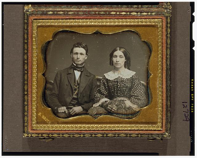 [Unidentified man and woman, seated, facing front]