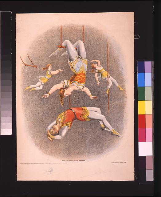 Male and female trapeze performers