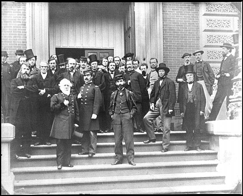 [Washington, D.C. Brig. Gen. Charles Thomas, Assistant Quartermaster General, with Benjamin C. Card and George D. Wise, Division Chiefs, and other staff on steps of Quartermaster General's office, Corcoran's Building, 17th St. and Pennsylvania Ave., NW]