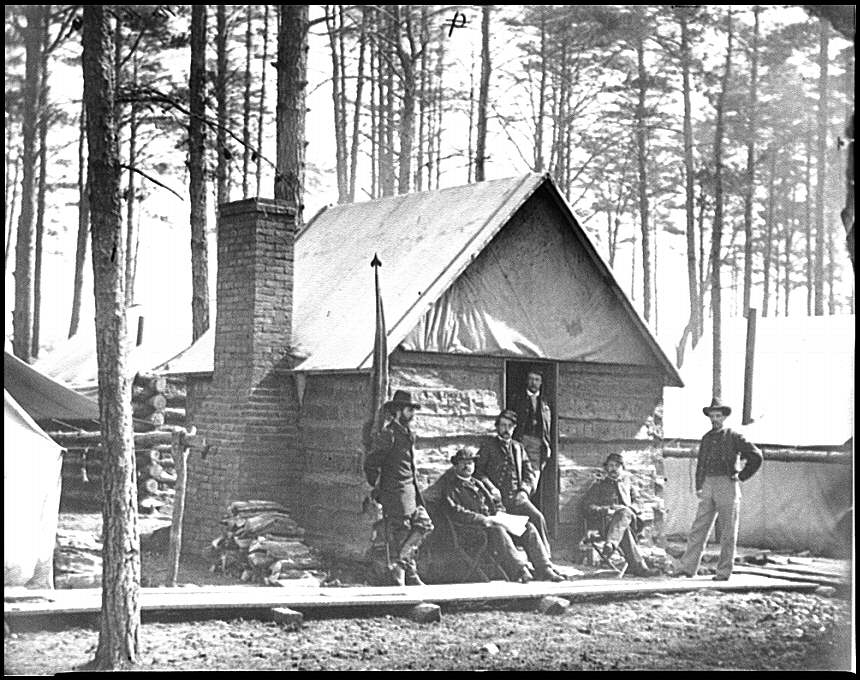 [Brandy Station, Va. Officers in front of winter quarters at Army of the Potomac headquarters]