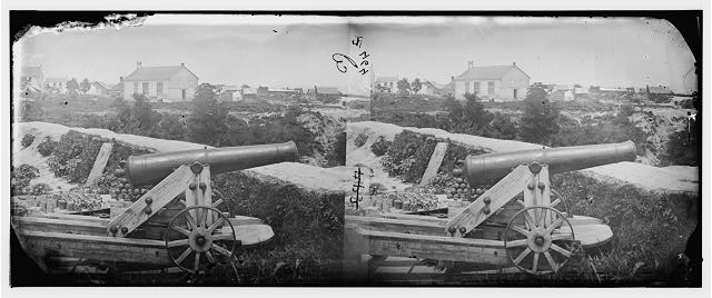 [Yorktown, Va. Confederate naval gun; in background is Nelson Church, used as a hospital]
