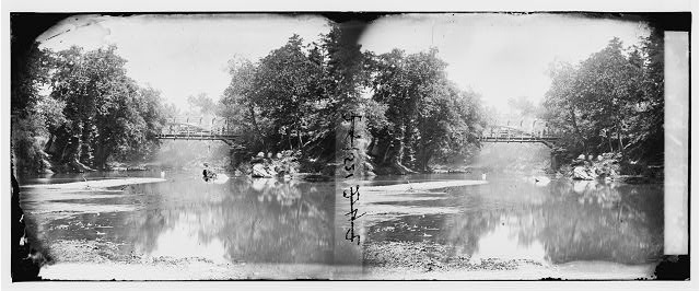 Hazel River, Virginia. View of river with bridge in the distance